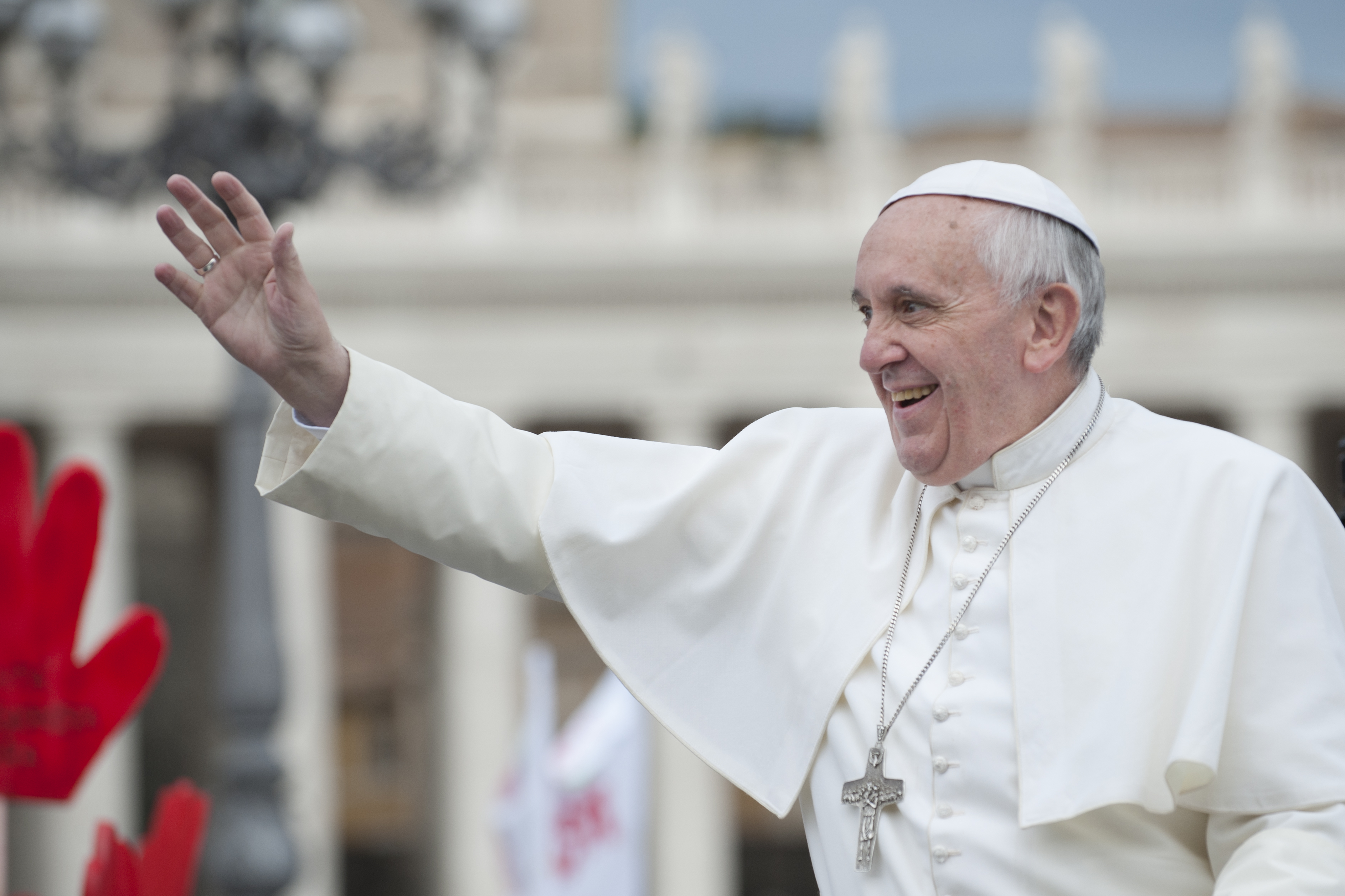 Vatican City, Rome, Italy - November 13, 2013: Pope Francis on the popemobile blesses the faithful in St. Peter's Square.